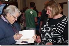 Janet gets her copy of Beths book autographed