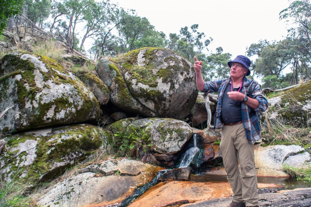 Neil Phillips explaining the formation of granite boulders at the Wallaby Gulley Nature Reserve